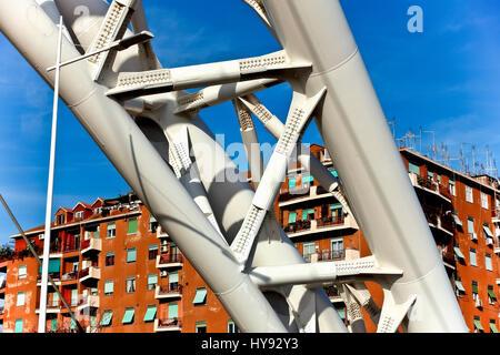 Settimia Spizzichino Bridge. Modern suspended white steel bridge  joining Garbatella and Ostiense, two historic - Stock Photo