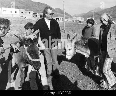 German Federal Chancellor Willy Brandt (M) and his wife Rut (R) ride on donkeys during a trip to the mountains in - Stock Photo