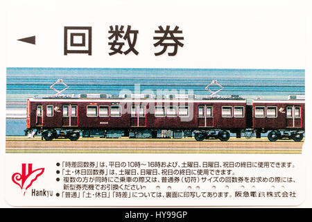 Japanese Hankyu Railway pre-payment electronic multi-ticket card.  Picture of hankyu train. - Stock Photo