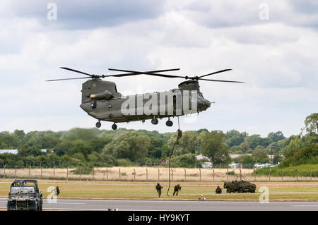 RAF Chinook deploying RAF Regiment Troops - Stock Photo