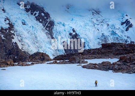 Winter mountains landscape with lonely hiker, Mt Cook national park, South island of New Zealand - Stock Photo