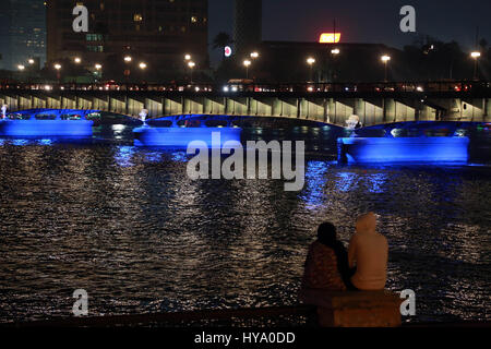Cairo, Egypt. 2nd Apr, 2017. The Nile Palace Bridge is illuminated in blue for the World Autism Awareness Day in - Stock Photo