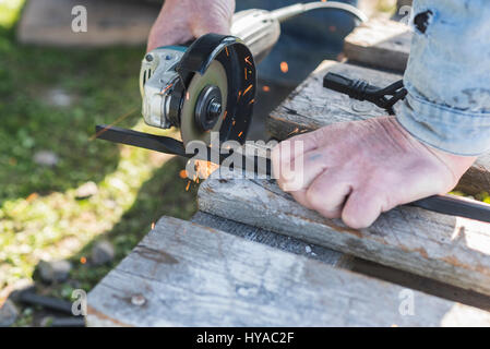 The process of cutting metal using the angle grinder. - Stock Photo