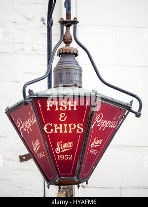 Fish & Chip Shop Sign - Old fashioned hanging sign outside Poppies fish and chips shop near Spitalfields Market - Stock Photo