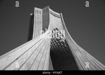 Monochrome image of the Azadi Tower, formerly Shahyad Tower, Azadi Square, Tehran, Islamic Republic of Iran - Stock Photo