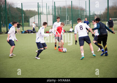 Teenagers playing 5 A Side football in Dublin city, Ireland. - Stock Photo