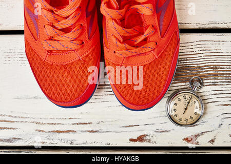 Sport shoes and stopwatch. - Stock Photo