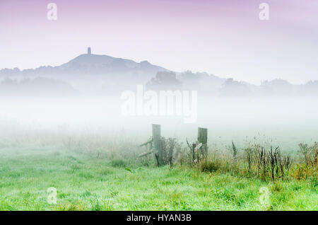 SOMERSET, UK: Fog transformed Glastonbury Tor into the Island of Avalon. HAUNTING pictures show legendary Avalon - Stock Photo