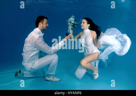 ALL ROUND EXCLUSIVE. ODESSA, UKRAINE: Bride and groom pose for underwater snap showing the proposal. NEWLYWEDS are - Stock Photo