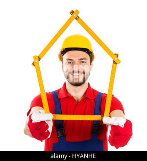 new house and improvement concept - construction worker with wooden ruler in hands - Stock Photo