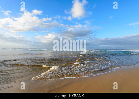 Gentle waves lapping at Conjola Beach, South Coast, New South Wales, NSW, Australia - Stock Photo