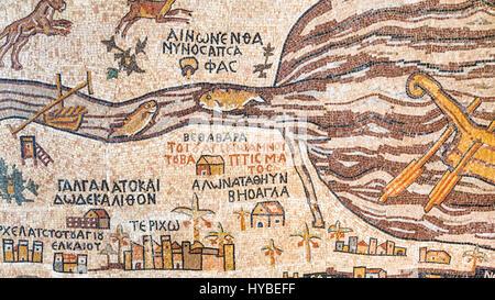 DEAD SEA, JORDAN - FEBRUARY 19, 2012: Modern replica of historical Madaba map. Madaba Mosaic Map is part of floor - Stock Photo