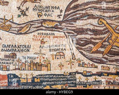 DEAD SEA, JORDAN - FEBRUARY 19, 2012: modern replica of ancient Madaba map. Madaba Mosaic Map is part of floor mosaic - Stock Photo