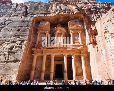 PETRA, JORDAN - FEBRUARY 21, 2012: view of al-Khazneh temple (The Treasury) and tourists in ancient Petra. Rock - Stock Photo
