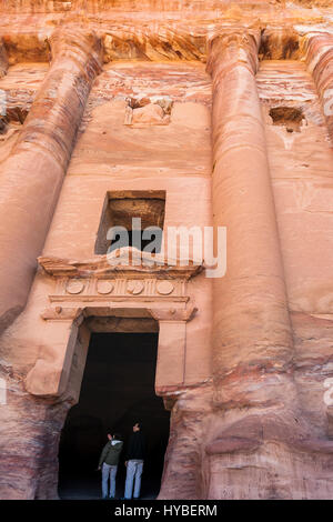 PETRA, JORDAN - FEBRUARY 21, 2012: tourists in door of Royal Urn Tomb in ancient Petra town. Rock-cut town Petra - Stock Photo