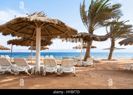 Travel to Middle East country Kingdom of Jordan - empty Coral beach of Red Sea in Aqaba city in windy winter day - Stock Photo