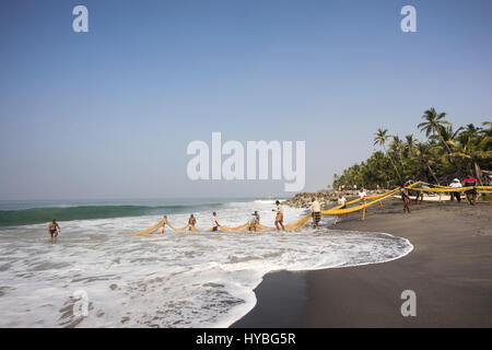 Fishermen working, near Varkala, Kerala - Stock Photo