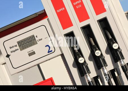 gas pump with 3 nozzles - Stock Photo