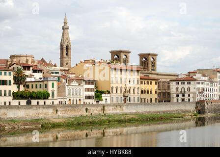 Looking east from the Ponte alle Grazie bridge over the River Arno in Florence, Italy, towards the Central Library. - Stock Photo