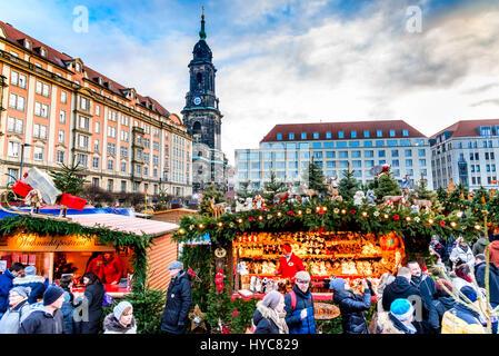 DRESDEN, SAXONY / GERMANY -  17 DECEMBER 2016: People visit Christmas Market  Striezelmarkt in Dresden, Germany. - Stock Photo