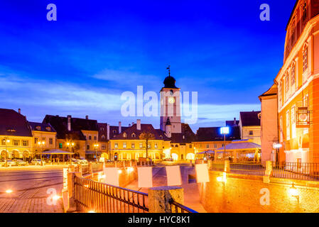 Sibiu, Romania. Twilight image of Council Tower in Small Square, Transylvania. - Stock Photo
