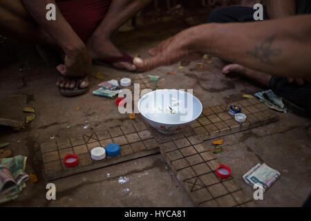 man playing mahjong on the street, mandalay, myanmar, burma - Stock Photo