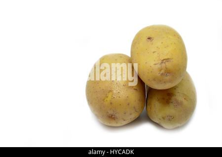 Ratte potatoes heap isolated on a white background - Stock Photo