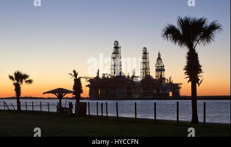Deep water drill rigs temporarily in storage,  sunset,  Harbor Island,  Canyon Port, Texas Gulf Coast,  Port Aransas.
