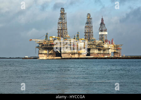 Deep water drill rigs temporarily in storage,  pm light, Harbor Island,  Canyon Port, Port Aransas.