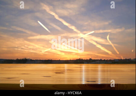 wooden desk with blurred sunrise background - Stock Photo