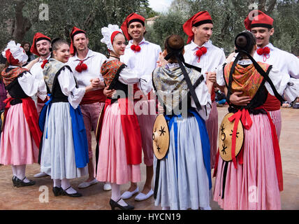 Folk dancers in the traditional costumes of Nice prepare to dance at a local festival - Stock Photo
