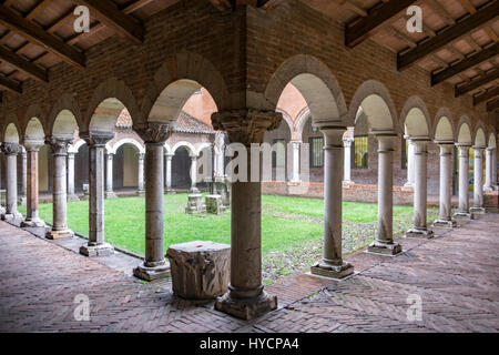 Interior of a cloister with an array of Doric and Corinthian columns on each side. - Stock Photo