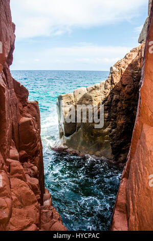 Arbatax the red porphyry rocks nearby port Capo Bellavista sardegna Sardinia Italy Europe - Stock Photo