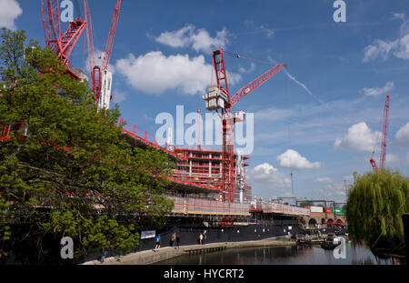 Construction and housing building work of homes and offices by Regent's canal for the Camden Lock Village development - Stock Photo