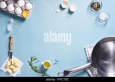 Cooking frame. Ingredients for preparing breakfast with eggs in a frying pan. Top view, text space. Flat lay. - Stock Photo