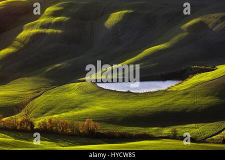 Tuscany, Crete Senesi landscape near Siena, Italy, europe. Small lake, green fields. - Stock Photo