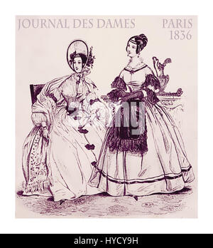 French 1836 fashion; two young ladies fancy dressed with hat and haido sitting indoors in the parlor - Stock Photo