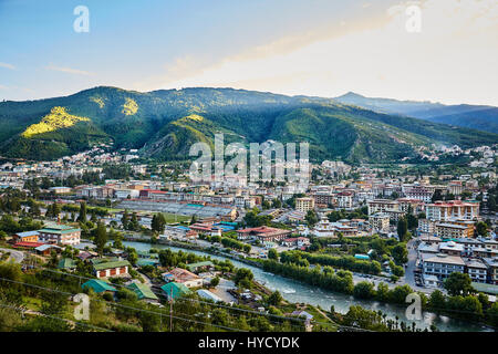 Thimphu, Bhutan City view from the other side of the river at sunset - Stock Photo