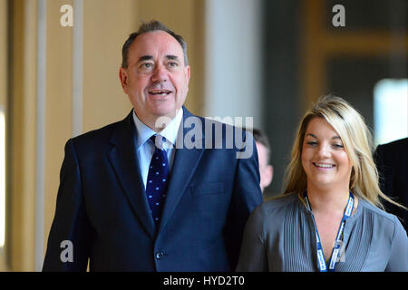 Scotland's First Minister Alex Salmond makes his way to the chamber of the Scottish Parliament to make a statement - Stock Photo