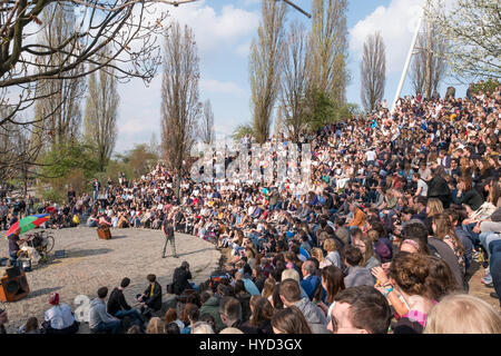 Berlin, Germany - april 02, 2017: People at Mauerpark watching the sundays Karaoke show in Berlin, Germany. - Stock Photo