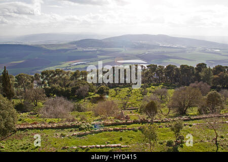 View of the large fertile Jezreel Valley and the Tavor Mountain from the Mount Precipice, Lower Galilee, Israel. - Stock Photo