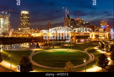 Twilight over Cumberland Park and the skyline of Nashville, Tennessee, USA - Stock Photo