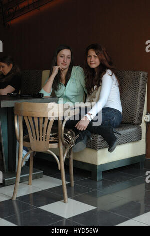 Girls form cafe bar - Detail from the streets of Sankt-Peterburg, Russia - Stock Photo