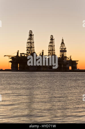Deepwater drill rigs temporarily in storage, sunset,  Harbor Island,  Canyon Port, Port Aransas.