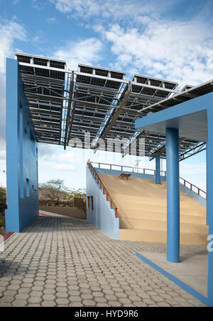 Solar panels form the roof of a multi-use building on Floreana island. - Stock Photo