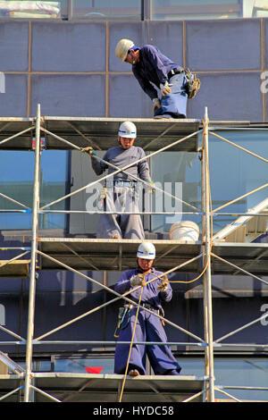 Scaffolders Working in a Construction Site in Kita-ku Tokyo Japan - Stock Photo