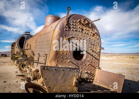 Abandoned rusty old train in train cemetery, Bolivia - Stock Photo
