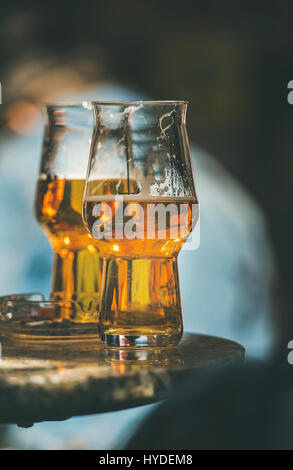Two glasses of beer on a table in street cafe - Stock Photo