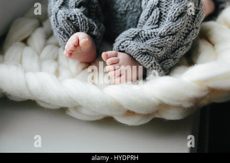 Small baby in knitted clothes - Stock Photo