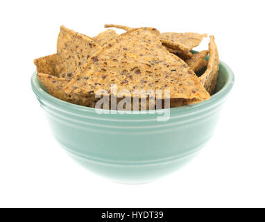 A small bowl filled with salt and pepper seasoned beans and rice chips isolated on a white background. - Stock Photo